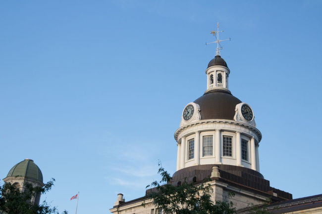 Kingston. The city that was first founded in 1673. Instrumental in our early Canadian history from the War of 1812, to Confederation. Architecture Building Exterior City Clear Sky Clock Day Low Angle View No People Outdoors Religion Sky