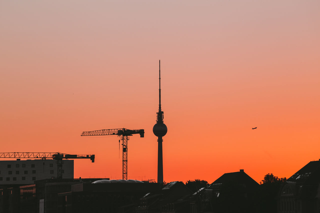 Fernsehturm in city during sunset