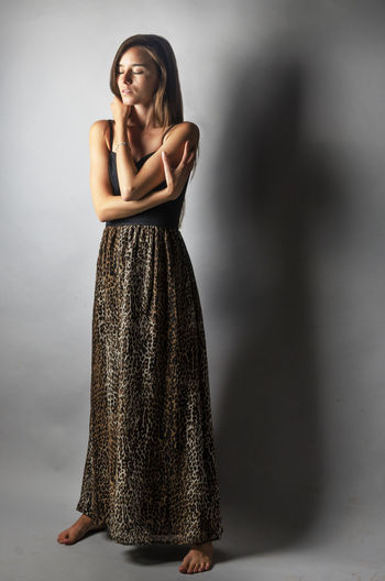 Studio Shot Fashion Portrait Girl Model Fashion Photography Woman Dress Dreamy Israel Book Photography Studio Animalprint Fantasy Gray Background Full Length One Person Only Women Adults Only One Woman Only Beauty Standing People Indoors  Adult