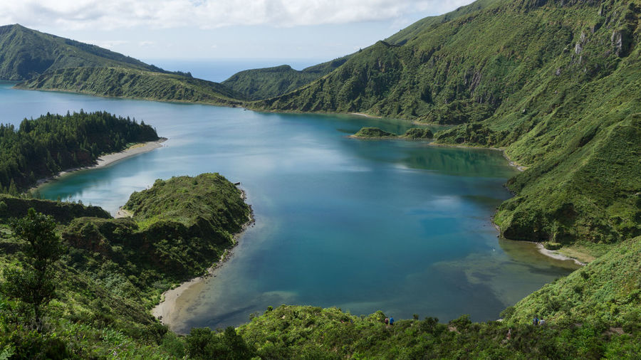 Lagoa do Fogo, Azores, Portugal. Azores Lagoa Do Fogo Portugal Sao Miguel- Azores Beauty In Nature Cloud - Sky Day Hot Spring Idyllic Lake Landscape Mountain Mountain Range Nature No People Outdoors Physical Geography Scenics Sky Tranquil Scene Tranquility Tree Water