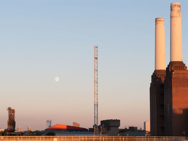 Moon over Battersea Power Station at sunset Architectural Column Architecture Battersea Power Station Building Exterior Built Structure City Moon No People Outdoors Sky Smoke Stack Sunset