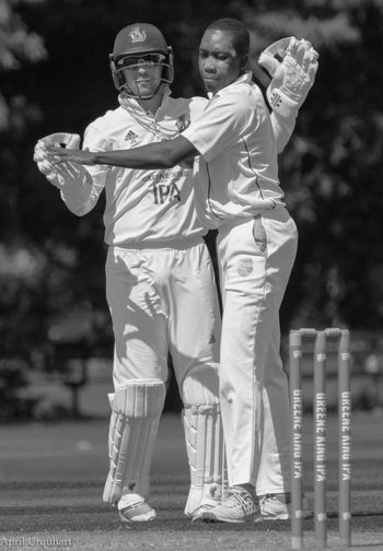'Black and white in black and white' two cricketers celebrating. Black And White Black And White Collection  Black And White Portrait Celebration Cricket Cricket Match Cricket Players Cricket! Cricketer Full Length Leisure Activity Lifestyles Man To Man Manlove Men Outdoors Real People Sport Sports Clothing Sports Photography Sportsman Two People Wicket Keeper Young Adult
