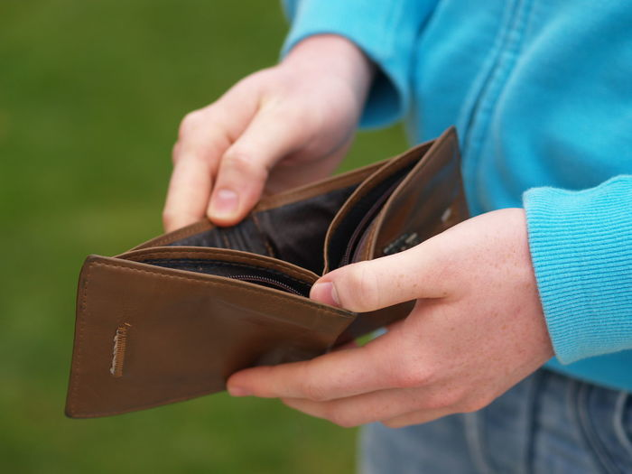 Cropped image of man holding empty wallet