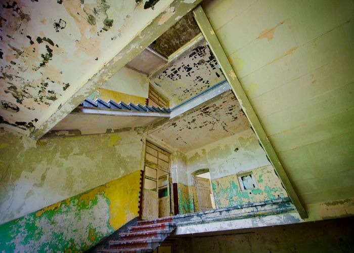My Eyes For Architecture EyeEm_abandonment Architecture Low Angle View Wall - Building Feature Indoors  Abandoned No People Built Structure Damaged Building Staircase Steps And Staircases Weathered Old
