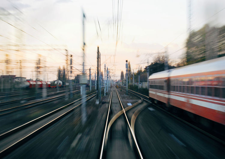 Blurred motion of train in city against sky