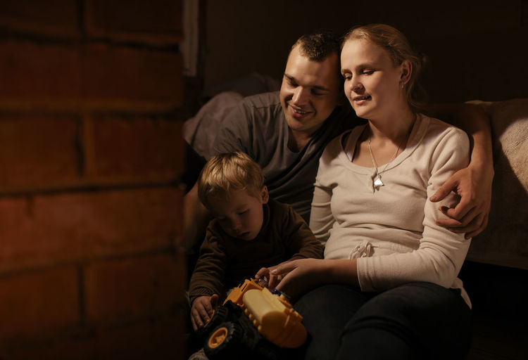Smiling family in dark at home