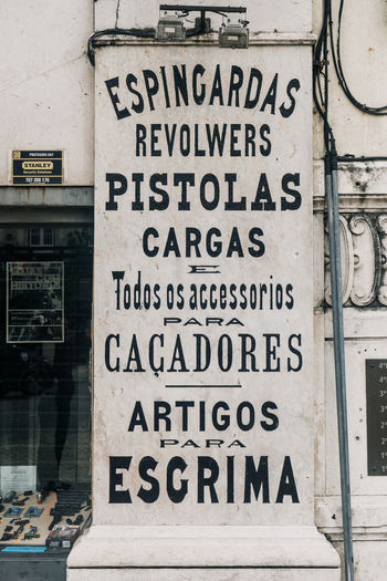 Gun Portugal Portuguese Architecture Built Structure Capital Letter City Communication Fencing Information Information Sign No People Poster Text Travel Destinations Vintage Western Script