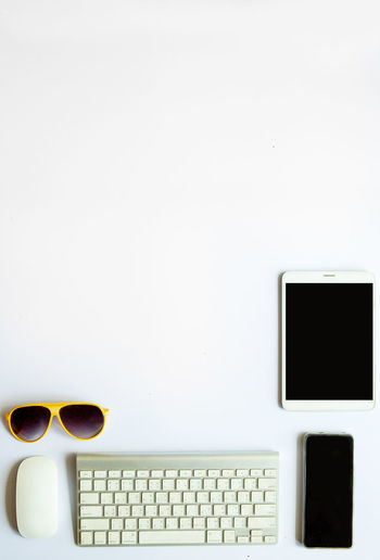 Directly above shot of sunglasses and laptop on table