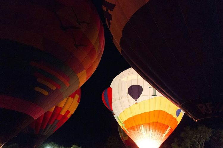 All lined up and ready to go. Winterfest Preparation  Hotairballoons Upcloseandpersonal Tucson Az Liftoff Capture The Moment Outdoor Photography Thephotographer Upupandaway Adventures Eye4photography  Arizona Tubac Myperspective Photography Nightphotography Festival Fire In The Sky All Lined Up In A Row Ready To Go Bottomview Stillness Artistsmind Anticipation Go Higher