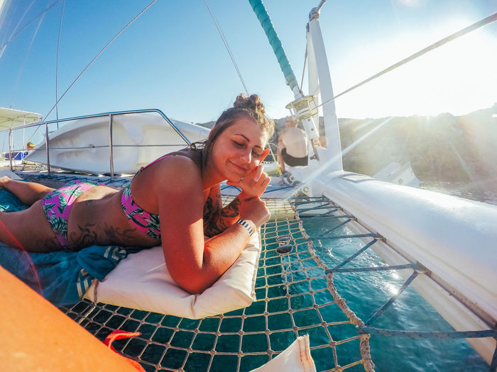 Catamaran Cyprus Adult Boat Day Leisure Activity Lens Flare Lifestyles Lying Down Nature Nautical Vessel One Person Outdoors Pool Real People Relaxation Sitting Sky Sun Sunlight Swimming Pool Transportation Vacation Water Young Adult