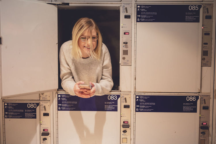 Young woman relaxing in locker