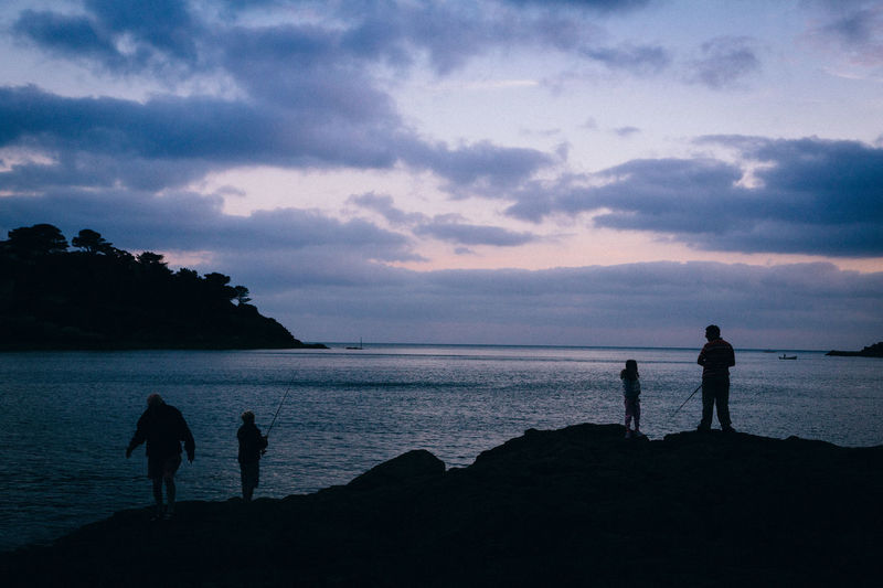 Beach Beauty In Nature Cloud - Sky Full Length Horizon Over Water Leisure Activity Lifestyles Men Nature Outdoors Real People Scenics Sea Silhouette Sky Standing Sunset Three People Togetherness Tranquil Scene Tranquility Vacations Walking Water Women
