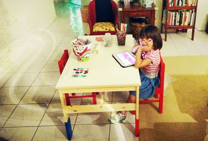 Liking her new table. Kids