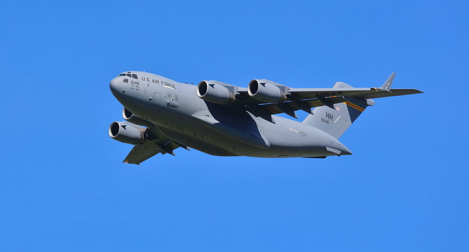 "The New Zealand Air Force recently celebrated their anniversary, with military planes & jet fighters from a number of countries turning up to partake in their achievement. This American Air Force transporter plane, A ""Globemaster"" jet plane, was one of the highlight air displays of the two day airshow. Air Show Airplane American Air Force Blue Colour Blue Sky Clear Sky Close-up Cloudless Day Eye4photography  EyeEm EyeEm Gallery Flying Flying Display Focus On Detail Grey Colour Jet Plane Light And Shadow Low Angle View Low Flying Military Military Air Transport Military Airplane Outdoors Transporter Plane"