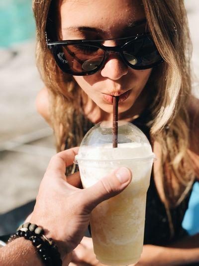 Close-up portrait of woman holding ice cream