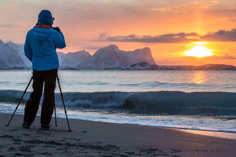 Adventure Beauty In Nature Camera - Photographic Equipment Cloud - Sky Cold Temperature Full Length The Great Outdoors - 2017 EyeEm Awards Landscape Mountain Nature Northern Norway Norway Outdoors People Photographer Photographing Photography Themes Rock - Object Sea Sen Sky Snow Sunset Tripod Winter