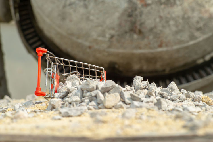 Selective focus on shopping trolley carries the crushed stones and pouring onto the pile at the construction site Falling Water Shopping Cart Construction Site Trolley Crushed Stone Textured  Backgrounds Rough