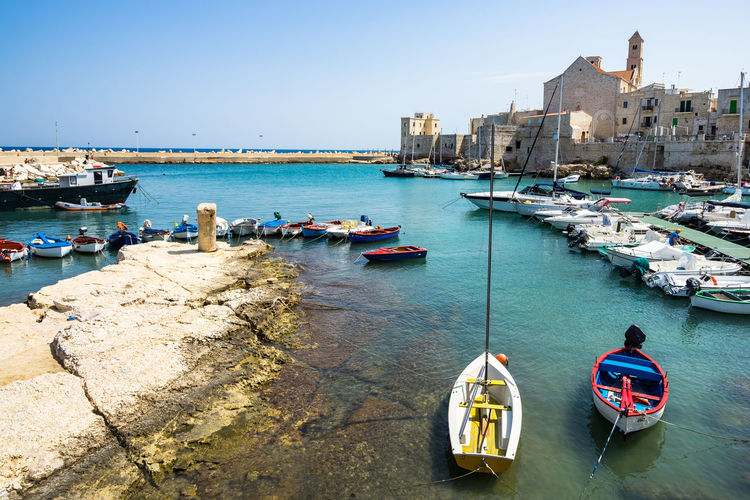 Colorful boats at Giovinazzo port, Apulia, Italy Apúlia Puglia Architecture Building Building Exterior Built Structure Canal City Clear Sky Day Giovinazzo Group Of People Incidental People Italy Mode Of Transportation Moored Nature Nautical Vessel Outdoors Real People Sailboat Sea Sky Southern Italy Transportation Travel Water