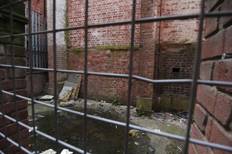 A view of yard in Shrewsbury Bars Building Exterior Compound Derelict Footpath Grill Mesh Shrewsbury Shrine Streetphotography Yard