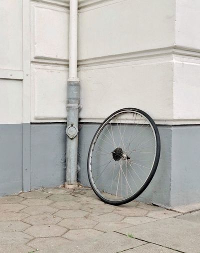 Bicycle on wall of building