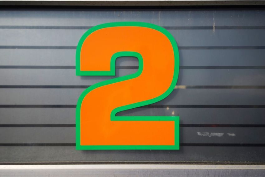Communication No People Number Text Sign Wall - Building Feature Day Orange Color Architecture Western Script Green Color Outdoors Close-up Symbol Information Guidance