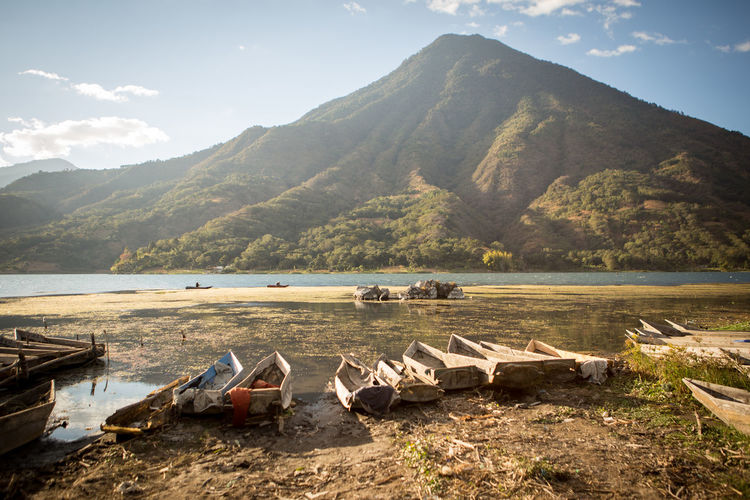 Fishing boats on Lake Atitlán, Santiago Atitlán, Guatemala. Beach Beauty In Nature Day Guatemala Lake Lake Atitlan Guatemala Lake Atitlán Lakeshore Landscape Mountain Nature No People Outdoors Scenics Tranquil Scene Tranquility Travel Destinations Water