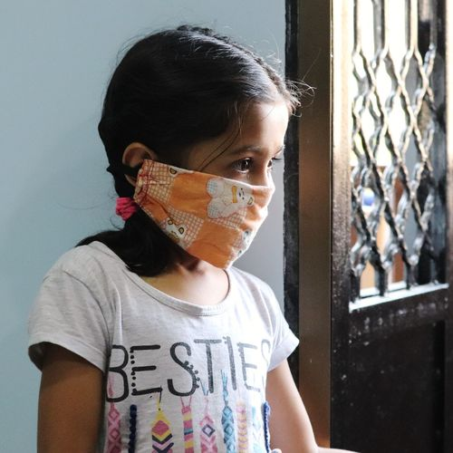 Close up of a little girl wearing corona mask