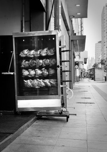 Chicken Food And Drink Machinery Blackandwhite Building Exterior Food Rotisserie Street Streetphotography This Is Latin America The Street Photographer - 2018 EyeEm Awards