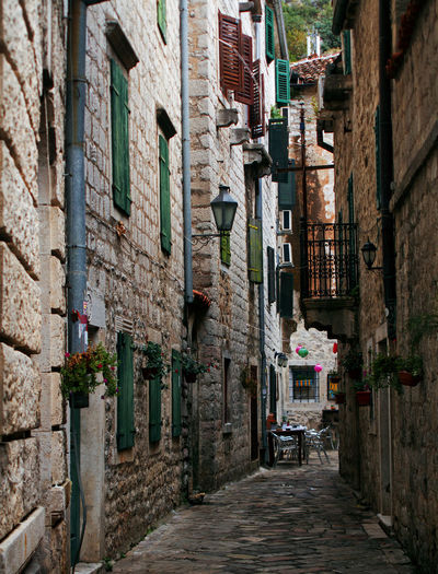 Narrow street amidst old buildings in town