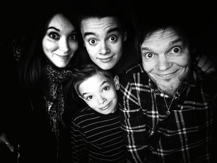 Portrait of family against black background
