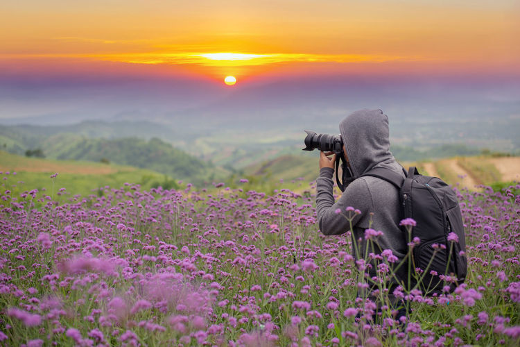 Beauty In Nature Sky Sunset Flower Nature Field One Person Scenics - Nature Plant Real People Land Flowering Plant Environment Purple Landscape Adult Tranquil Scene Growth Agriculture Tranquility Outdoors Bacpacker Travel Photography Photographer Tourism Tourist Hikking Trekking Mountain Peak Top View Sun Sunrise Morning Evening Landsape Scenery