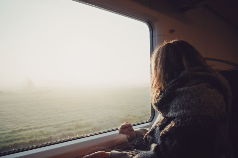 Girl in train looking through window Autumn Fall Colors Field Morning Light Nature Rear View Soft Light Traveling Beauty In Nature Fog Foggy Girl Leisure Activity Looking At View Looking Through Window Mode Of Transport Rear View Season  Sunrise Teenager Train Transportation Warm Clothing Window Young Woman My Best Photo