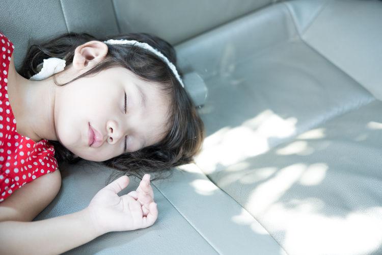 High angle view of girl sleeping on floor