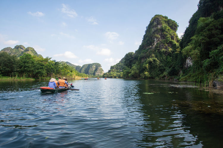 travel at Trang An, Ninh Binh, Vietnam Water Nautical Vessel Transportation Waterfront Mode Of Transportation Plant Beauty In Nature Sky Real People River Day Tree Nature Men Leisure Activity Lifestyles Two People Scenics - Nature Outdoors