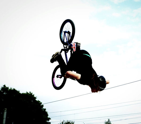 Shreddin Backflip Activity Adventure Bmx Cycling Competitive Sport Danger Extreme Sports Full Length Helmet Leisure Activity Lifestyles Low Angle View Men Mid-air Motion One Person Outdoors Real People Riding RISK Skill  Sport Stunt Vitality