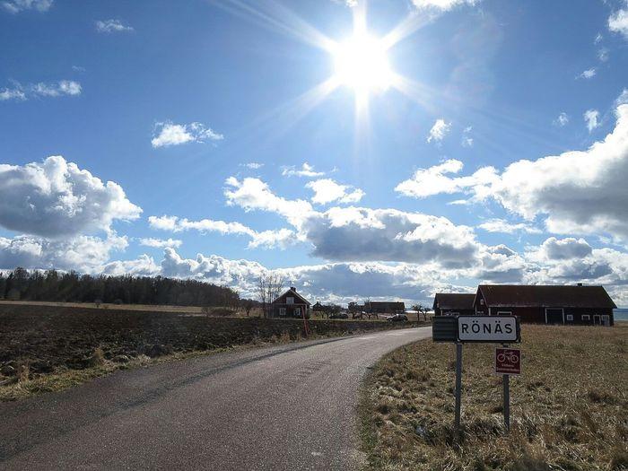 Landscape Road Signboard Rönäs Sky And Clouds Buildings Sunshine