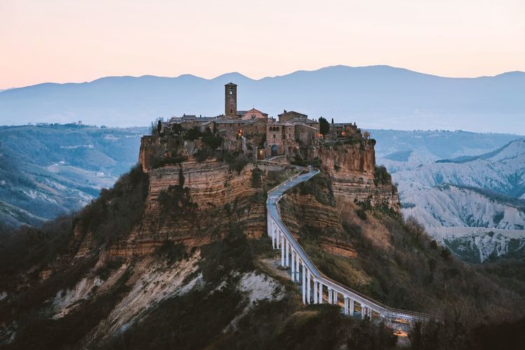 Civita di Bagnoregio Nature Sunrise Italy Landscape Mountain Built Structure Architecture Sky Building Exterior Mountain Range Nature Scenics - Nature Beauty In Nature Travel Destinations Travel Tourism The Past History Non-urban Scene Tree No People Tranquil Scene Plant Outdoors