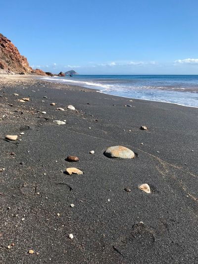 Stone Beach Sea Land Water Sand Sky Beauty In Nature Tranquility Nature Tranquil Scene Scenics - Nature Day No People Horizon Horizon Over Water Wave Motion Shell Sunlight