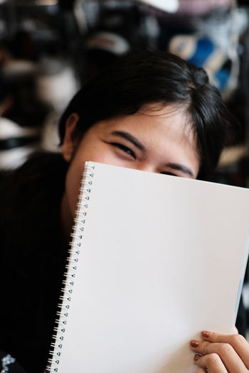 Close-up portrait of woman reading book