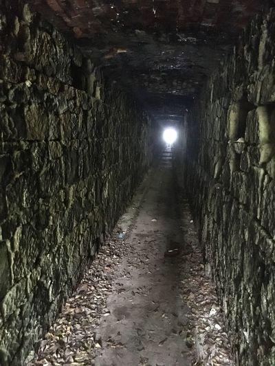 Footpath in illuminated tunnel