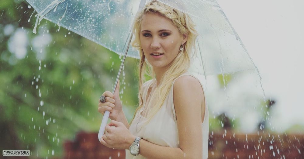 Something about the rain White Fun Lifestyles Portrait Enjoying Life Beauty Beautiful Woman Dress Outdoors Rain Rainy Days Umbrella