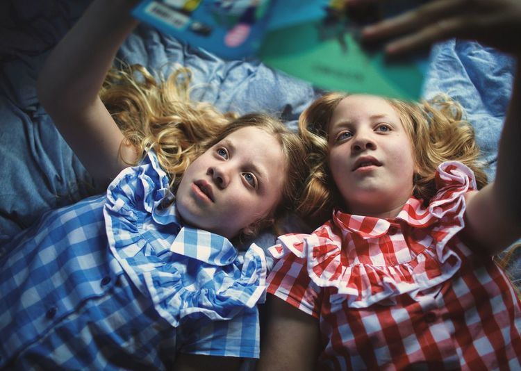 Children Laying Down Book Natural Light Natural Beauty Twins Reading Childhood Child Togetherness Females Family Girls Portrait
