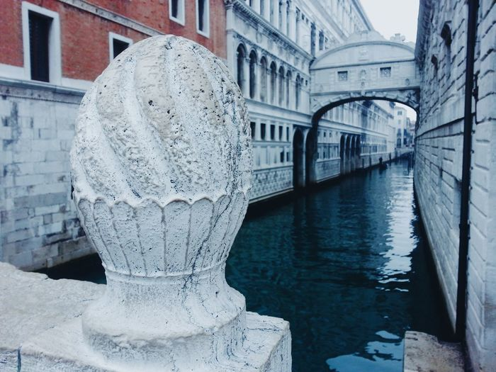 Closeup on an historical bridge, with the Doge Palace and the Bridge of Sighs in the background, wintertime Architecture Bridge Bridge Of Sighs Building Exterior Built Structure Canal Day Doge's Palace Explore Historical Building Horizontal Journey Mystery No People Outdoors Poetic Reflection San Marco Travel Travel Destinations Venezia Venice, Italy Water Winter Wintertime