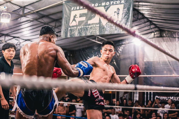 Alvin Vs. Ian (I) Sport Boxing - Sport Competition Group Of People Athlete Vitality Determination Healthy Lifestyle Strength Boxing Ring Lifestyles Muscular Build Young Men Men Adult Young Adult Competitive Sport Shirtless Exercising People Punching Effort Muay Thai Kicking Fighting Fit Fitness