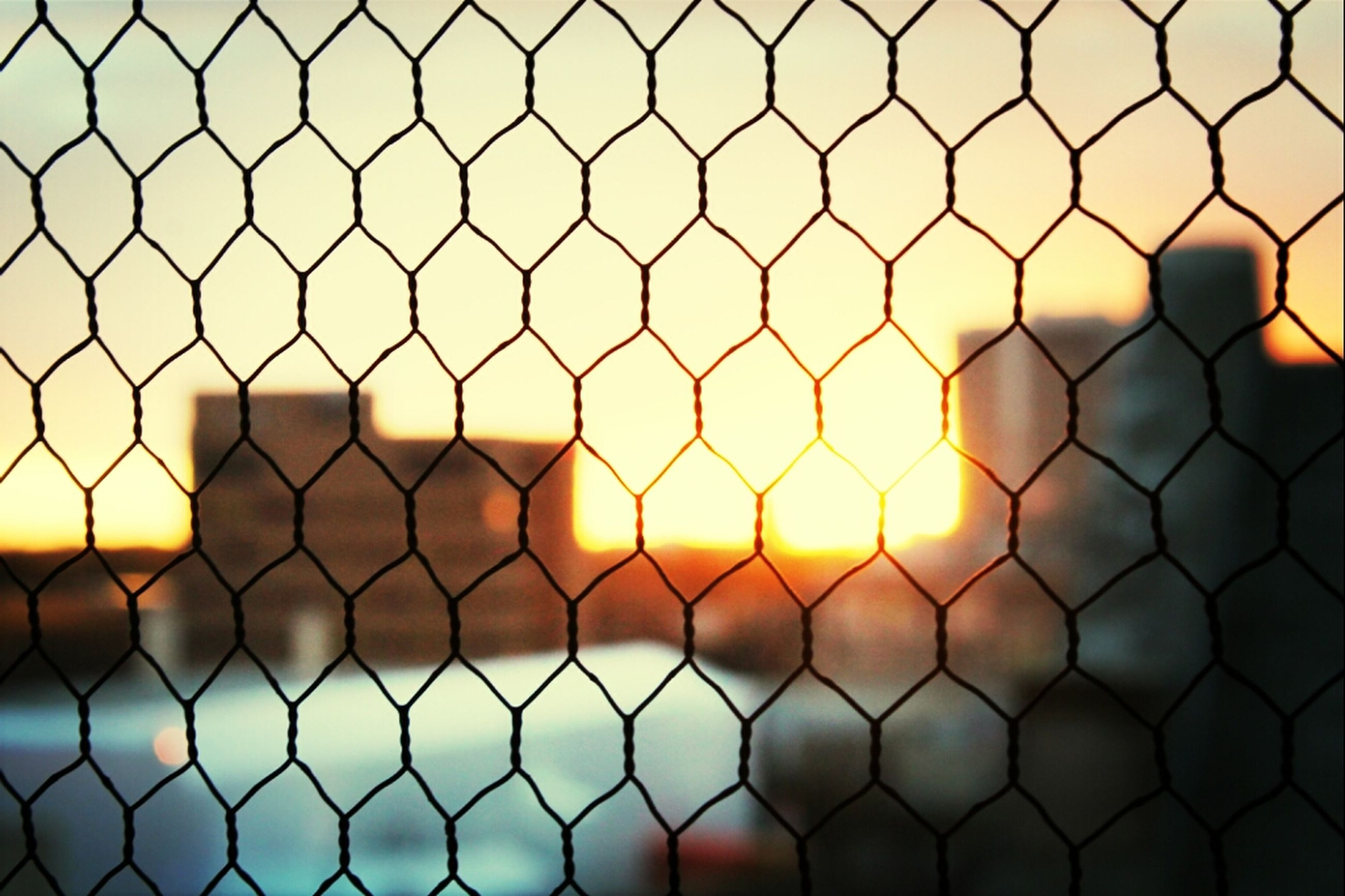 chainlink fence, fence, protection, safety, full frame, security, metal, backgrounds, focus on foreground, pattern, close-up, outdoors, yellow, no people, day, metallic, metal grate, sky, sunset, design