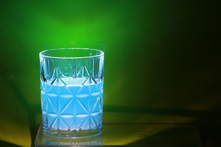 Transparency blue juice on green background Beautiful Blue Color Bright Colors Green Color Juice Light Reflection Textures Vegetarian Food Arts Culture And Entertainment Beauty Blue Sky Colorful Creative Design Drink Food Glass Drink Ideas Object Shadow Texture Transparency Transparent
