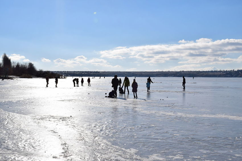 Blue Ice Adults Only Outdoors Lake People Sky Cold Temperature Ice Rink Adult Nature Women Day Togetherness Teamwork Silhouettes Frozen Frozen Lake Winterscapes Walking Around The Purist (no Edit, No Filter) Walking On The Beach People On Ice Sunny Winter Day Frozen Photography