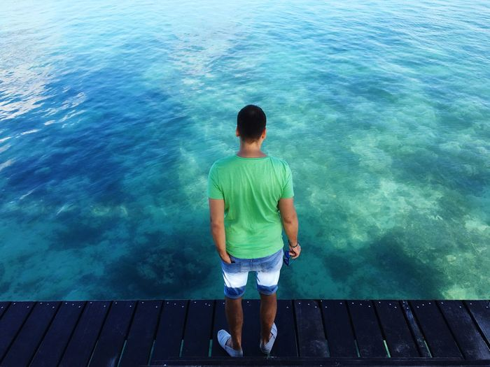 Man by the sea Boatpier Paradise Holiday Mauritius Calm Thoughtful Green Color Green Shirt  Water Rear View One Person Real People High Angle View Standing Sea