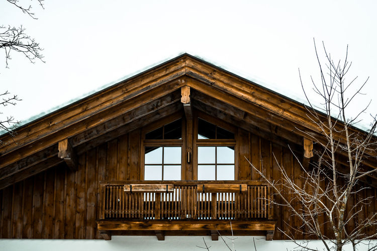 Log cabin Architecture Built Structure Low Angle View Building Exterior No People Day Building Outdoors Wooden House Winter Barn Winter Cabin Log House Wood House Log Cabin Winter Holidays Vacations Culture Skihütte Holzhütte Skiurlaub Winter Hotel Hotel Snow Bavaria Sky Wood - Material Clear Sky Tree Nature The Past History Window Plant Bare Tree Railing Travel Destinations
