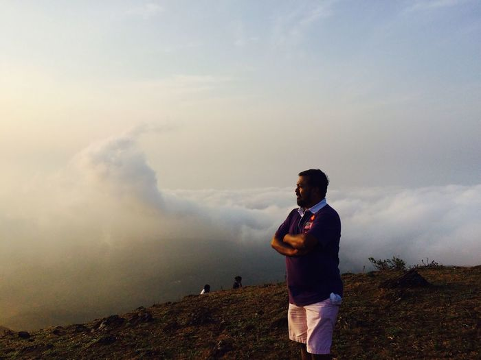 Early morning ride to mullayangiri hills, highest peak of Karnataka, India. Real People One Person Standing Sky Nature Men Leisure Activity Cloud - Sky Casual Clothing Taking Photos